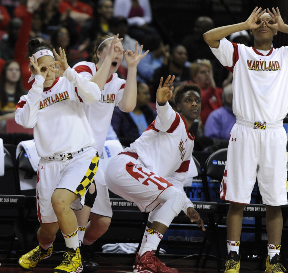 Photo - Maryland players, from left to right, Chloe Pavlech, Tierney Pfirman, Laurin Mincy and Brene Moseley react after Katie Rutan hit a three-point basket against Army during the second half of the first round of the NCAA women's college basketball tournament on Sunday, March 23, 2014, in College Park, Md. Maryland won 90-52. (AP Photo/Gail Burton)