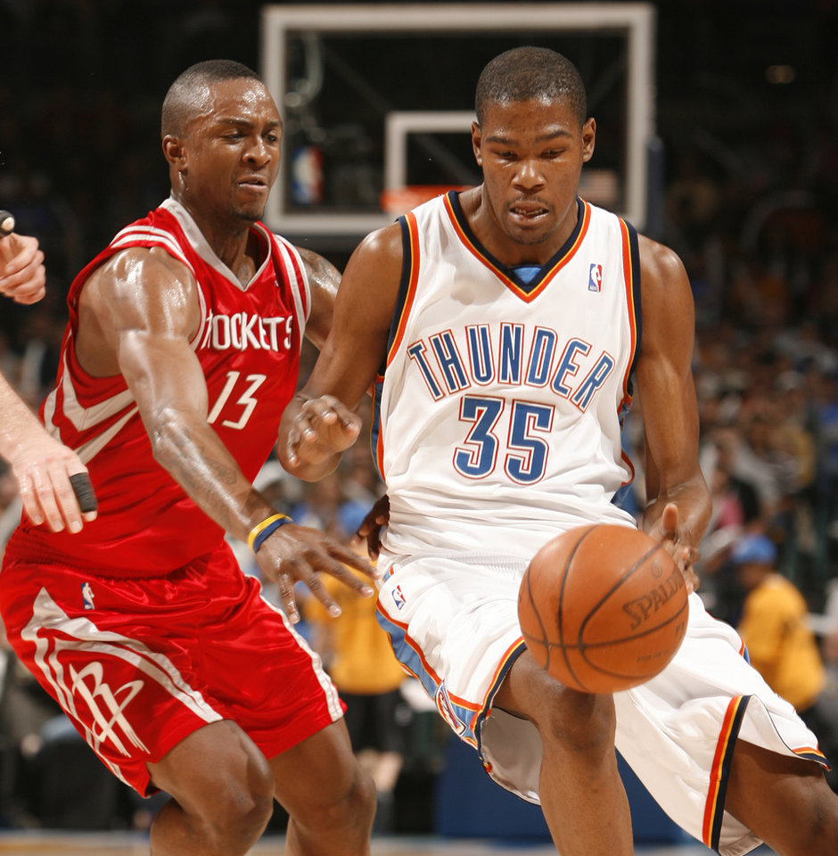 Devin Durant  dribbles past Von Wafer in the first half as the Oklahoma City Thunder plays the Houston Rockets at the Ford Center in Oklahoma City, Okla. on Friday, January 9, 2009. 