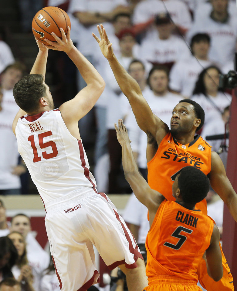 Photo - OU's Tyler Neal (15) shoots against OSU's Brian Williams (4) and Stevie Clark (5) in the first half during the NCAA men's Bedlam basketball game between the Oklahoma State Cowboys (OSU) and the Oklahoma Sooners (OU) at Lloyd Noble Center in Norman, Okla., Monday, Jan. 27, 2014. Photo by Nate Billings, The Oklahoman