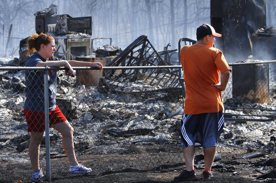 Photo - Residents in Luther were allowed to return to the their homes early Saturday, after they fled a rapidly moving wildfire. Photo by Jim Beckel, The Oklahoman.  Jim Beckel