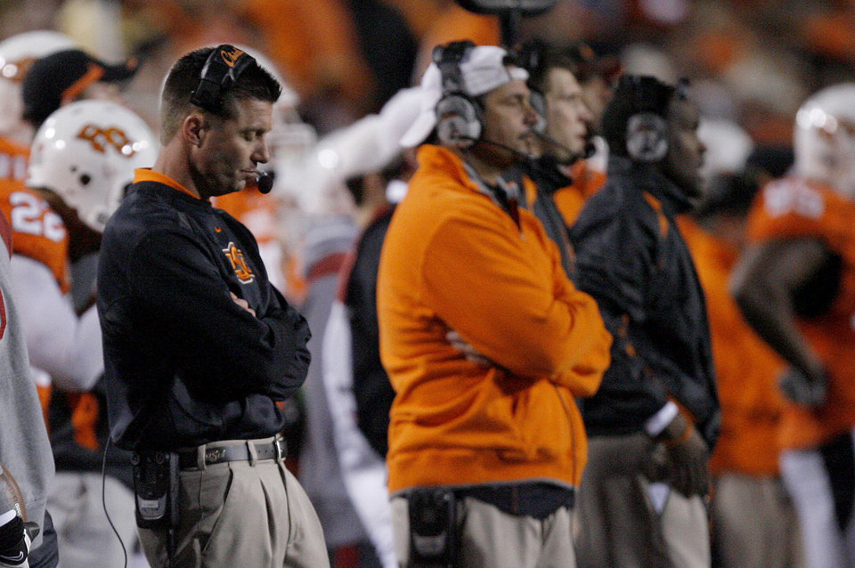 Photo - OSU head coach Mike Gundy reacts to a play during the Bedlam college football game between the University of Oklahoma Sooners (OU) and the Oklahoma State University Cowboys (OSU) at Boone Pickens Stadium in Stillwater, Okla., Saturday, Nov. 27, 2010. Photo by Sarah Phipps, The Oklahoman