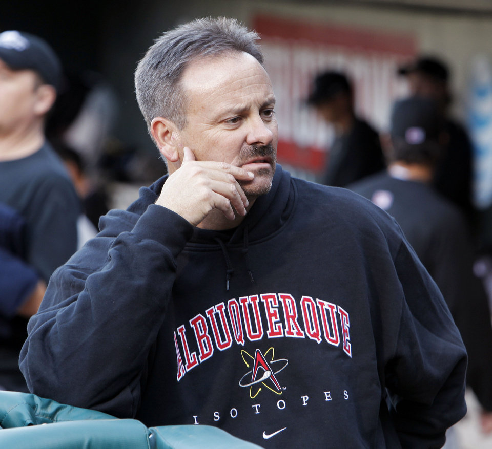 Albuquerque trainer Greg Harrel stands in the dugout before an  Oklahoma City RedHawks game against the Albuquerque Isotopes in 2010 in Oklahoma City.  <strong>NATE BILLINGS - THE OKLAHOMAN ARCHIVES</strong>