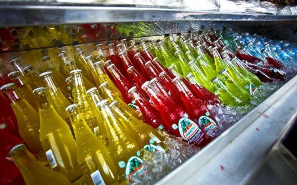 Photo - FOOD VENDORS: The colorful arrangement of sodas in the mobile Big Truck Tacos truck on Friday, July 16, 2010, in Oklahoma City, Okla.    Photo by Chris Landsberger, The Oklahoman ORG XMIT: KOD
