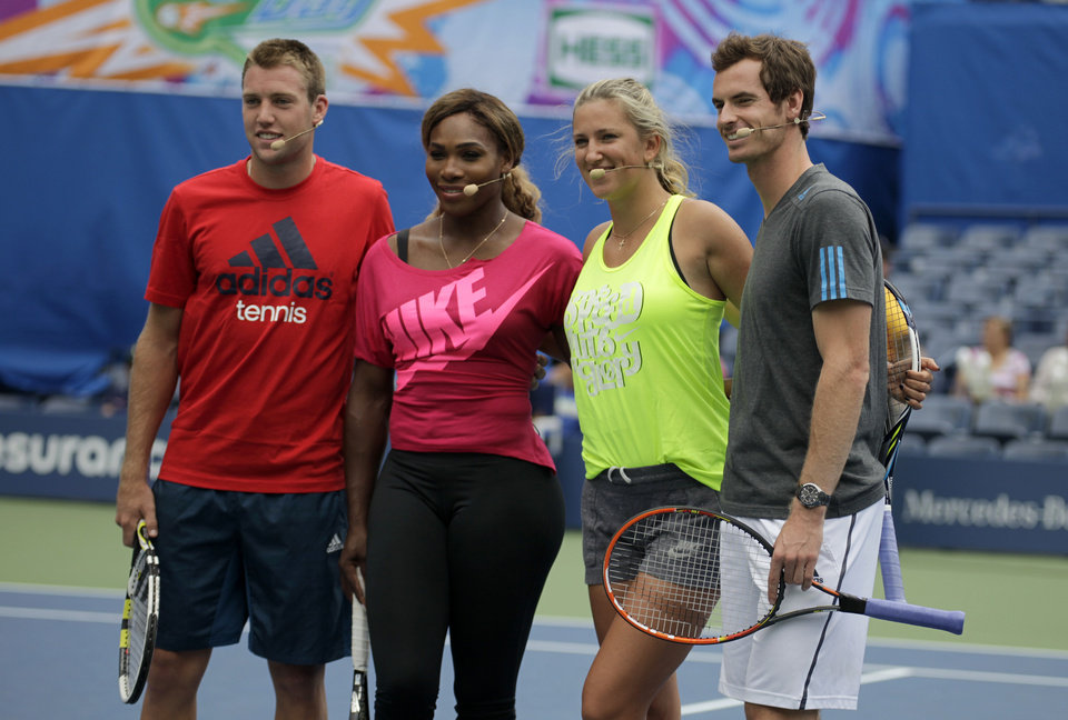 Photo - Tennis players, from left, Jack Sock, Serena Williams, Victoria Azarenka and Andy Murray appear at U.S. Open Arthur Ashe Kids Day at the USTA Billie Jean King National Tennis Center on Saturday, Aug. 23, 2014, in New York. (Photo by Andy Kropa/Invision/AP)