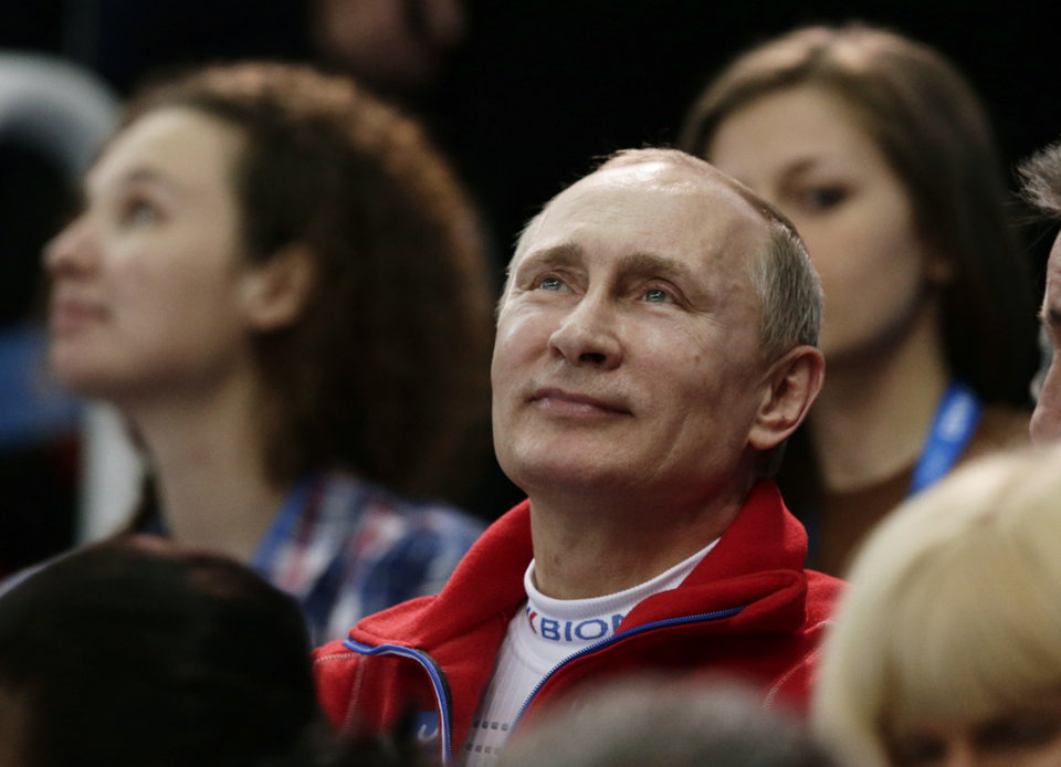 Photo - Russian President Vladimir Putin attends the figure skating competition at the Iceberg Skating Palace during the 2014 Winter Olympics, Sunday, Feb. 9, 2014, in Sochi, Russia. (AP Photo/Bernat Armangue)