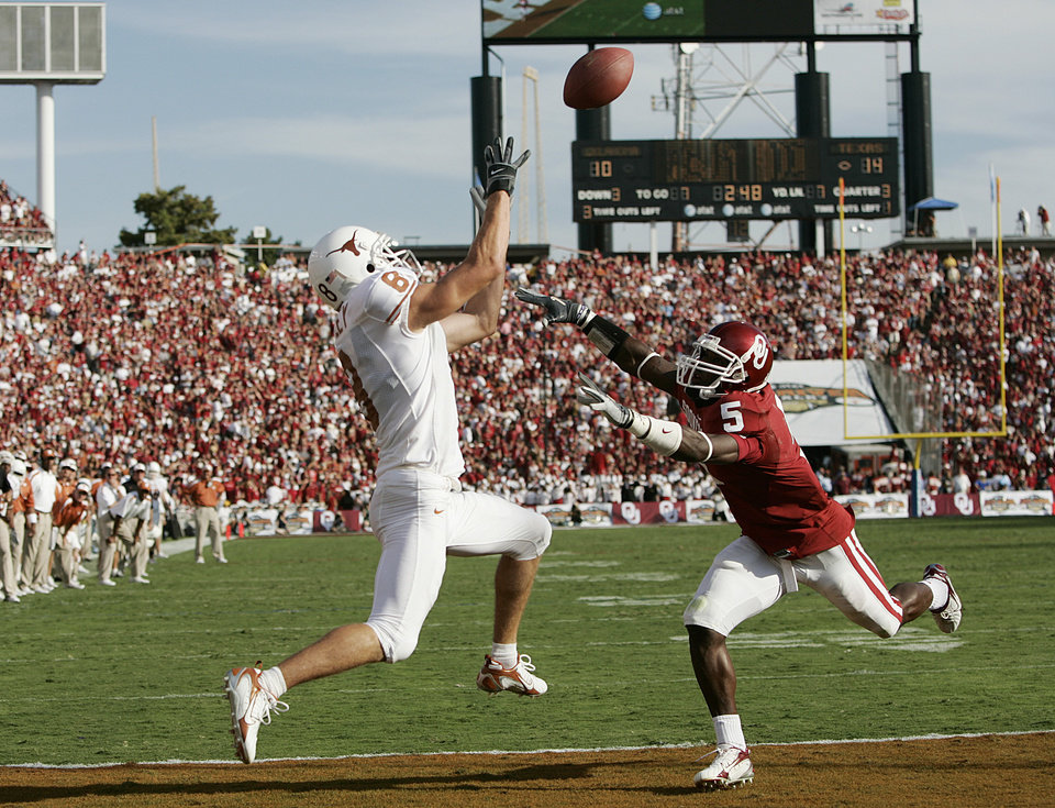 Photo - Texas receiver Jordan Shipley (8) catches a touchdown pass ahead of OU defender Nic Harris (5) in the end zone in the second half during the University of Oklahoma Sooners (OU) college football game against the University of Texas (UT), in the Red River Shootout at the Cotton Bowl, on Saturday, Oct. 7, 2006, in Dallas, Texas.    by Bryan Terry, The Oklahoman  ORG XMIT: KOD