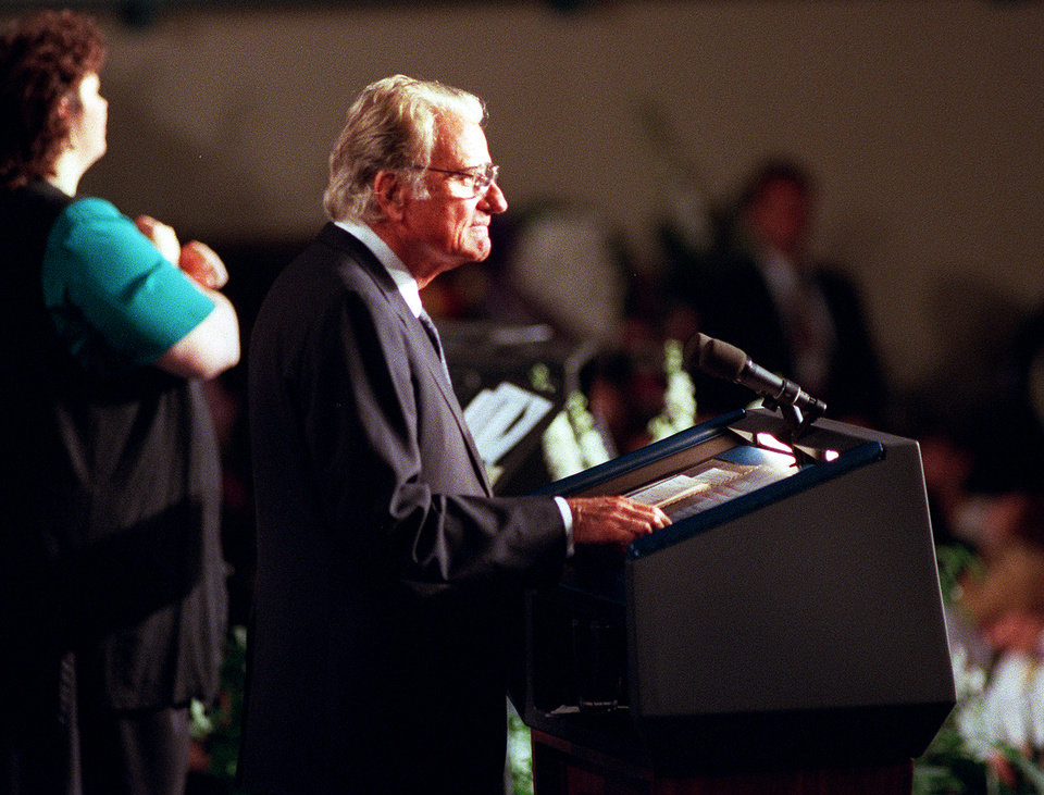 Photo - CAR BOMB EXPLOSION, BOMBING: Evangelist Billy Graham speaks at a memorial service for those killed in the truck bomb explosion that ripped through the Alfred P. Murrah Federal Building.  The memorial service was held April 23, 1995 and was attended by President Bill Clinton as well as state and local officials and family members of the dead and missing.  Staff Photo by Jim Argo.