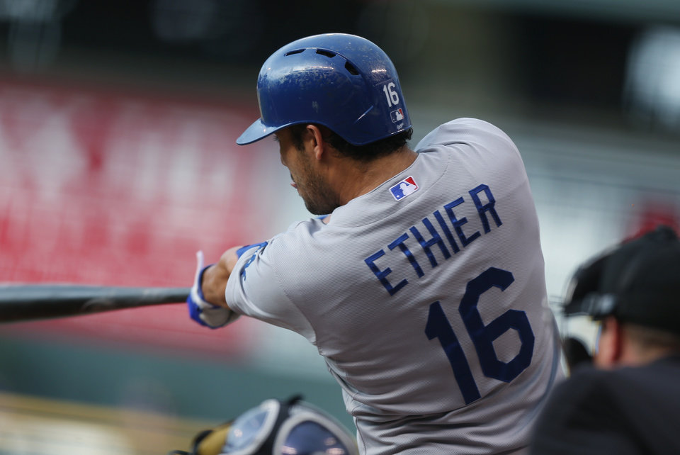 Photo - Los Angeles Dodgers' Andre Ethier follows through with his swing after connecting for an RBI-triple against the Colorado Rockies in the first inning of a baseball game in Denver, Friday, July 4, 2014. (AP Photo/David Zalubowski)