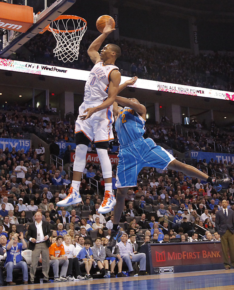 Oklahoma City Thunder point guard Russell Westbrook (0) misses a shot defended by New Orleans Hornets point guard Jarrett Jack (2) during the NBA basketball game between the Oklahoma City Thunder and the New Orleans Hornets at the Chesapeake Energy Arena on Wednesday, Jan. 25, 2012, in Oklahoma City, Okla. Photo by Chris Landsberger, The Oklahoman