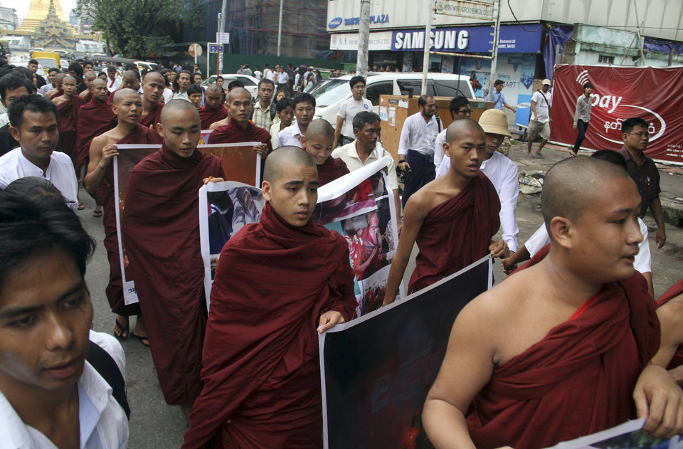 Buddhist monks march to protest against crackdown on protesters at the Letpadaung copper mine in Monywa, northwestern Myanmar, in Yangon, Myanmar, Friday, Nov. 30, 2012. Opposition leader Aung San Suu Kyi publicly criticized the forcible crackdown on protesters at the mine and said Friday that the public needed an explanation of the violence that injured dozens, including Buddhist monks. (AP Photo/Khin Maung Win)