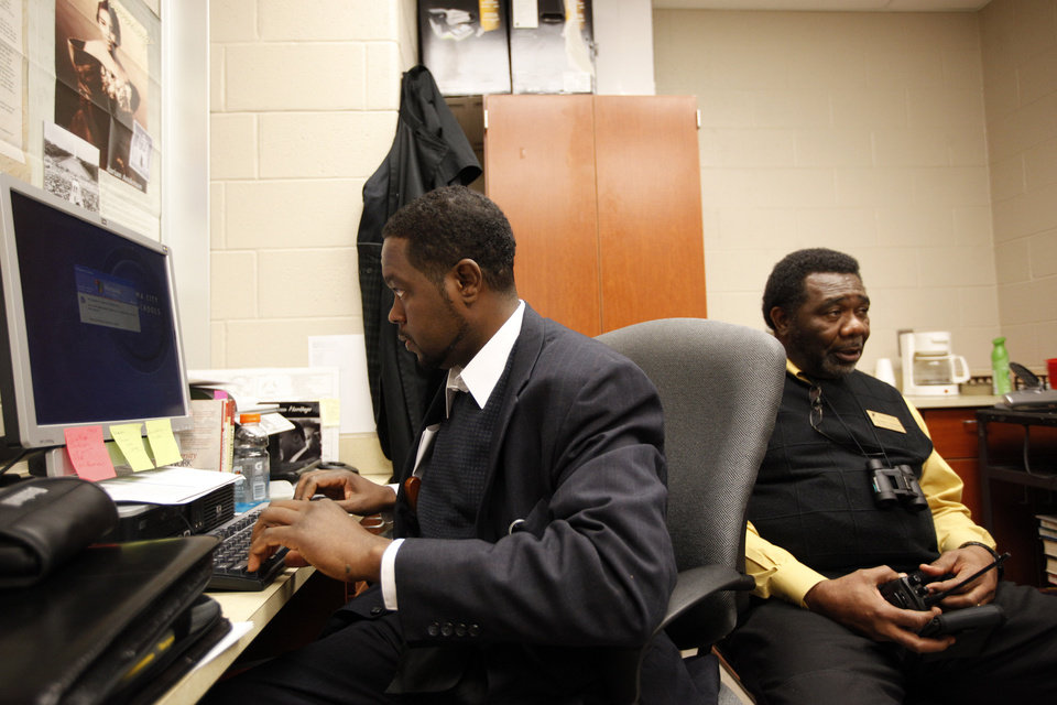 Ahiezer Black, left, and Reginald Mitchell are two of four full-time attendance advocates at U.S. Grant High School in southwest Oklahoma City. The four advocates work to help students with excessive absences get back on track to graduation. <strong>SARAH PHIPPS - THE OKLAHOMAN</strong>