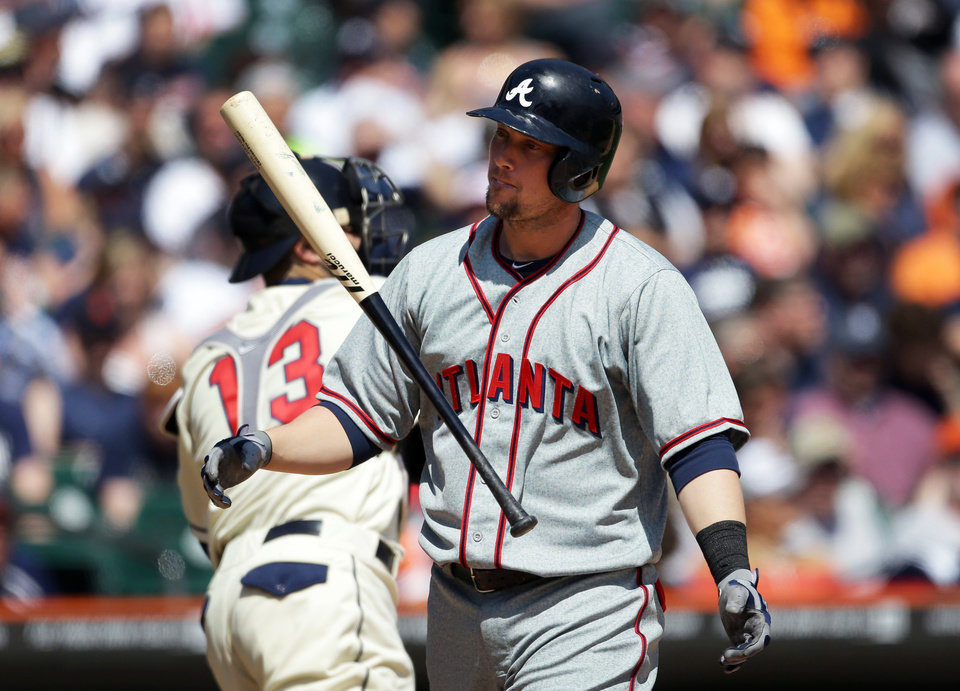 Photo - Atlanta Braves' Chris Johnson flips his bat after striking out during the sixth inning of an interleague baseball game against the Detroit Tigers in Detroit, Saturday, April 27, 2013. (AP Photo/Carlos Osorio)