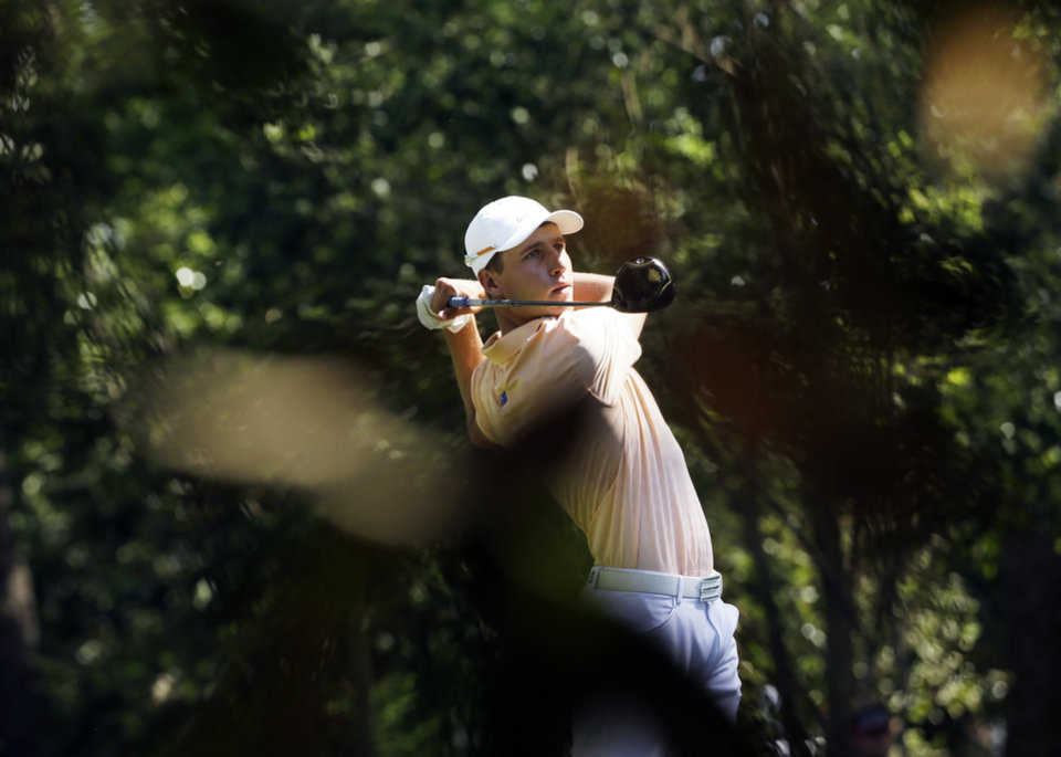 Photo - Oliver Goss, of Australia, tees off on the second hole during the third round of the Masters golf tournament Saturday, April 12, 2014, in Augusta, Ga. (AP Photo/David J. Phillip)