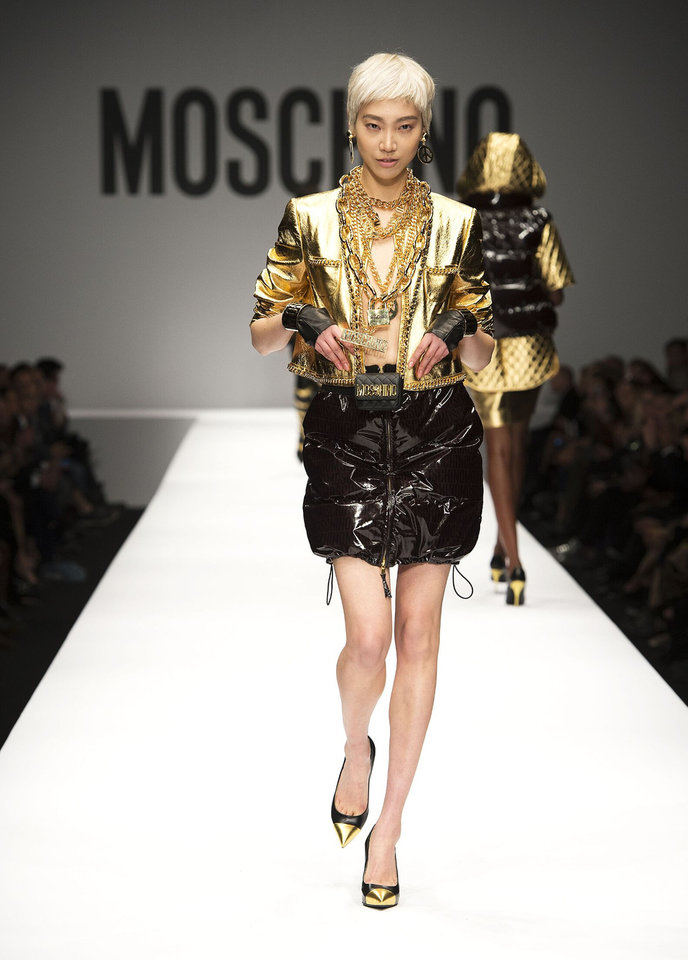 Photo -  Fashion forward: Colors that make a splash on fashion runways often find their way into future homes. 2014 fashions featured a lot of gold. PHOTO PROVIDED BY NIKKI CHU HOME