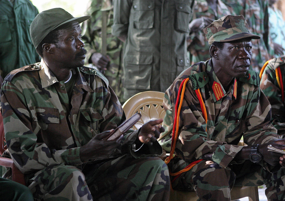 Photo -   FILE - In this Nov. 12, 2006 file photo Joseph Kony, the Lord's Resistance Army (LRA) leader, left, and his deputy Vincent Otti, sit inside a tent at Ri-Kwamba in Southern Sudan. A video by the advocacy group Invisible Children about the atrocities carried out by Kony's Lord's Resistance Army has rocketed into viral video, racking up millions of page views seemingly by the hour. The voices demanding that the U.S. Congress stop the brutality of African warlord Joseph Kony and his LRA belong to the nation's children, some of whose parents work in Congress. (AP Photo/Stuart Price, File, Pool)