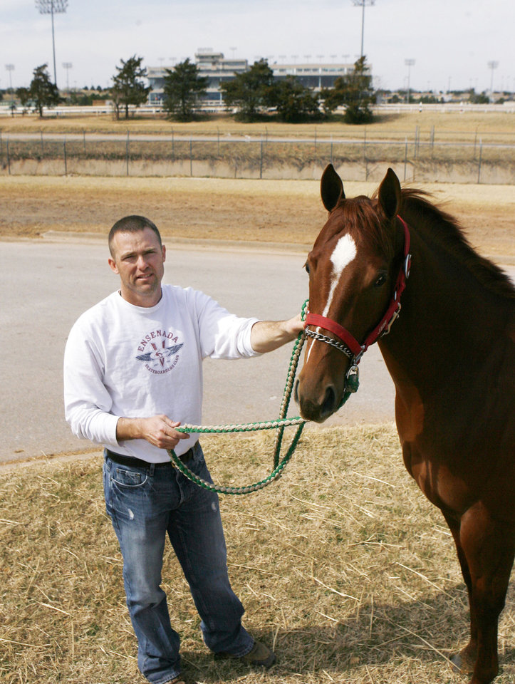 Photo - HORSE RACING / RACE HORSE: Horse trainer Heath Taylor works with