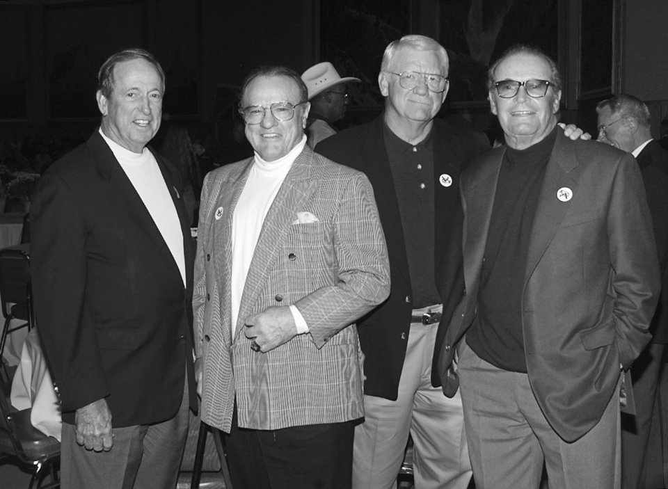 Photo - Vince Gill Celebrity Golf Tournament reception at the Cowboy Hall.  L-R are Bill Saxon, Don Klosterman, John David Crow, and James Garner.