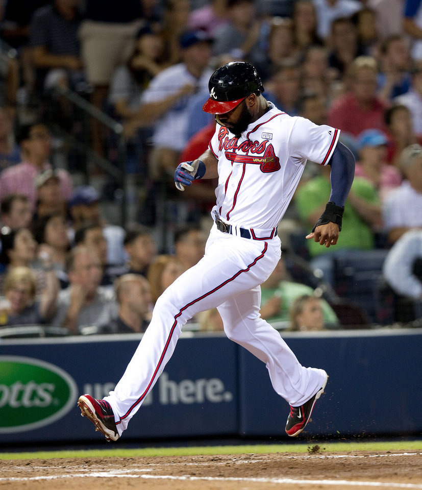 Photo - Atlanta Braves' Jason Heyward scores on a Justin Upton base hit in the fifth inning of a baseball game against the Los Angeles Dodgers Wednesday, Aug. 13, 2014, in Atlanta. (AP Photo/John Bazemore)