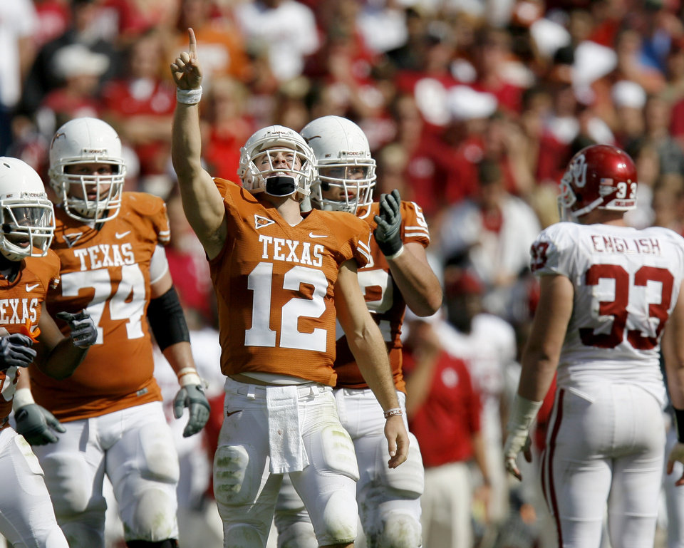 Photo - Colt McCoy of Texas celebrates after a first down in the fourth quarter of the Red River Rivalry college football game between the University of Oklahoma Sooners (OU) and the University of Texas Longhorns (UT) at the Cotton Bowl in Dallas, Texas, Saturday, Oct. 17, 2009. Photo by Bryan Terry, The Oklahoman