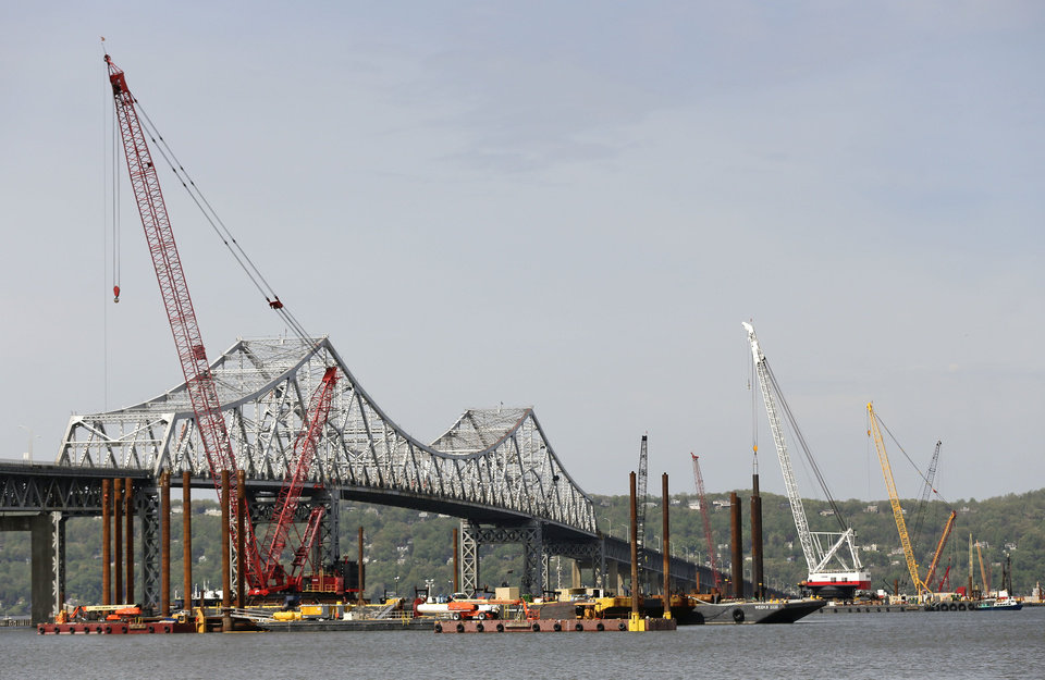 Photo - Construction crews use barges and cranes as work continues on a replacement for the 58-year-old Tappan Zee Bridge spanning the Hudson River, Tuesday, May 13, 2014, near Tarrytown, N.Y. On Wednesday, President Barack Obama plans to speak by the bridge just north of New York City to press his case that a key federal government fund used to pay for the nation's roads, bridges and ports is running dry and that the economy would be damaged if it is not replenished. (AP Photo/Julie Jacobson)