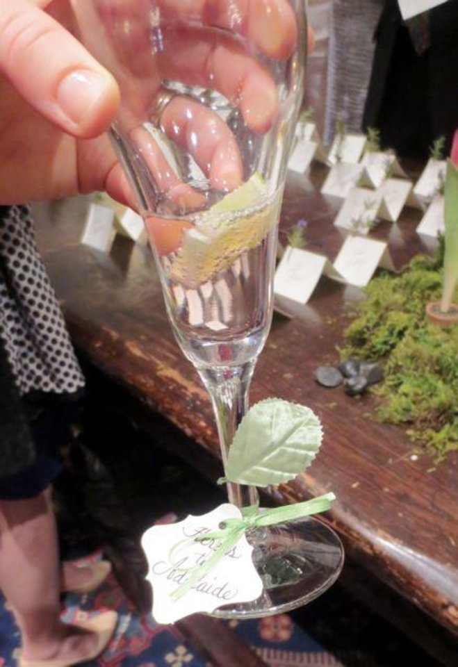 "Pomegranate spritzers were served and the stem of the glass held a sign saying ""Cheers to Adelaide"" and ""Cheers to Kathy."" (Photo by Helen Ford Wallace)."