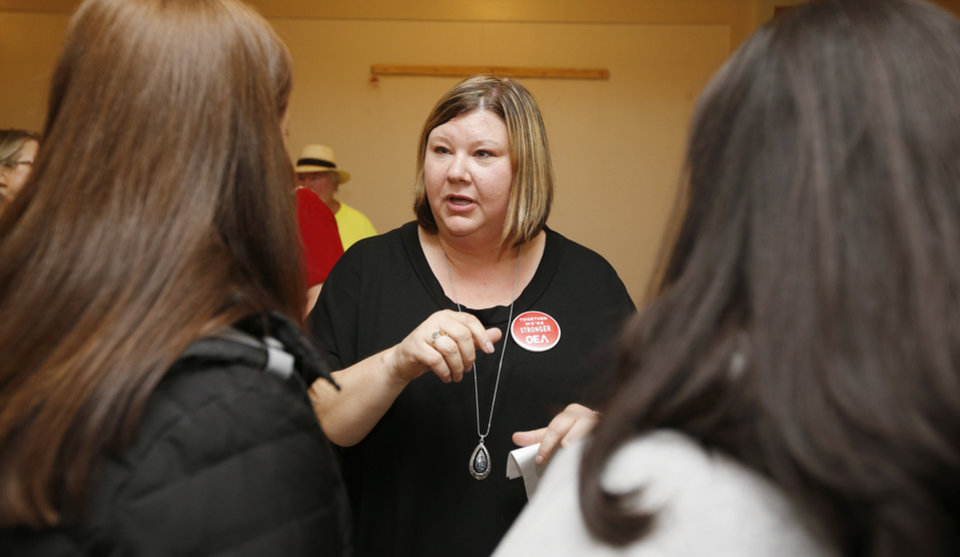 Photo - Alicia Priest, Oklahoma Education Association president, talks to teachers from Tahlequah, Okla., during the fifth day of a walkout by Oklahoma teachers at the state Capitol in Oklahoma City, Friday, April 6, 2018. Photo by Nate Billings, The Oklahoman