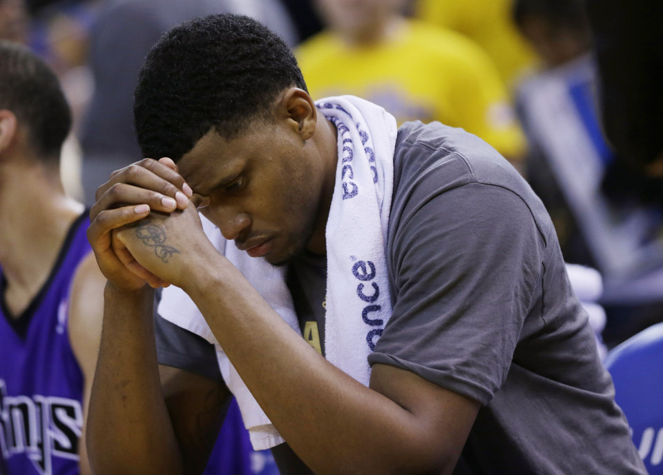 Photo - Sacramento Kings forward Rudy Gay looks down in the closing minutes of the Kings' 102-69 loss to the Golden State Warriors in an NBA basketball game Friday, April 4, 2014, in Oakland, Calif. (AP Photo/Marcio Jose Sanchez)