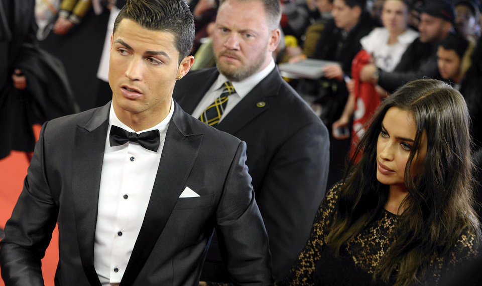 Photo - Soccer player Cristiano Ronaldo, left, of Portugal, arrives with his wife, Russian model Irina Shayk on the red carpet prior to the FIFA Ballon d'Or 2013 gala held at the Kongresshaus in Zurich, Switzerland, Monday, Jan. 13, 2014. (AP Photo/Keystone,Walter Bieri)