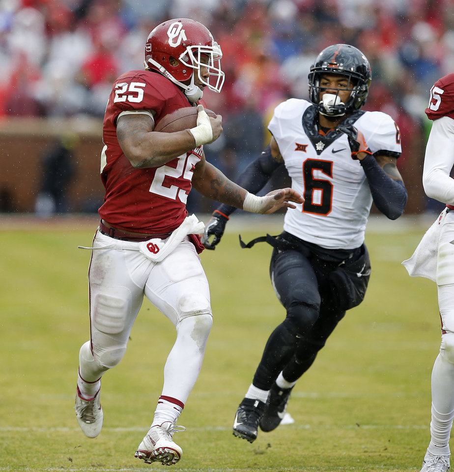 Photo - Oklahoma's Joe Mixon (25) runs for a touchdown past Oklahoma State's Ashton Lampkin (6) late in the fourth quarter of the Bedlam college football game between the Oklahoma Sooners (OU) and the Oklahoma State Cowboys (OSU) at Gaylord Family - Oklahoma Memorial Stadium in Norman, Okla., Saturday, Dec. 3, 2016. Oklahoma won 38-20. Photo by Bryan Terry, The Oklahoman