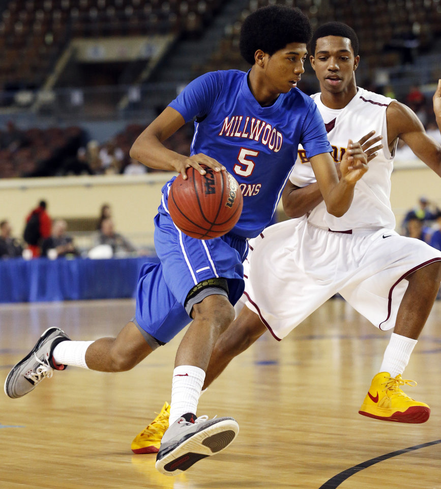 Millwood\'s Ashford Golden drives past Corneilous McKiver during the 3A boys semifinal game between the Millwood High School Falcons and the Centennial Bison at the State Fair Arena on Friday, March 8, 2013 in Oklahoma City, Okla. Photo by Steve Sisney, The Oklahoman