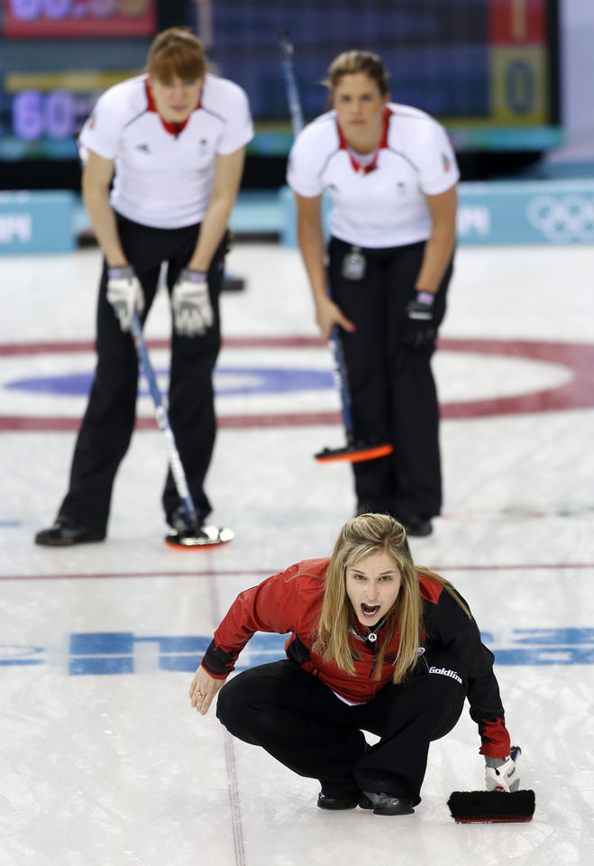 Photo - Canada's skip Jennifer Jones, lower, delivers shouts to her sweepers during women's curling competition against Great Britain at the 2014 Winter Olympics, Wednesday, Feb. 12, 2014, in Sochi, Russia. (AP Photo/Robert F. Bukaty)