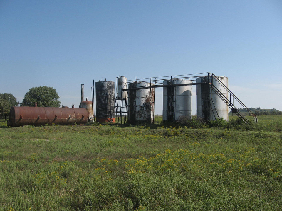 Contractors hired by the Oklahoma Energy Resources Board removed these rusty, abandoned storage tanks from the Osage County property owned by Earl and Dorothy Fink. It was OERB's 12,000th cleanup. <strong></strong>