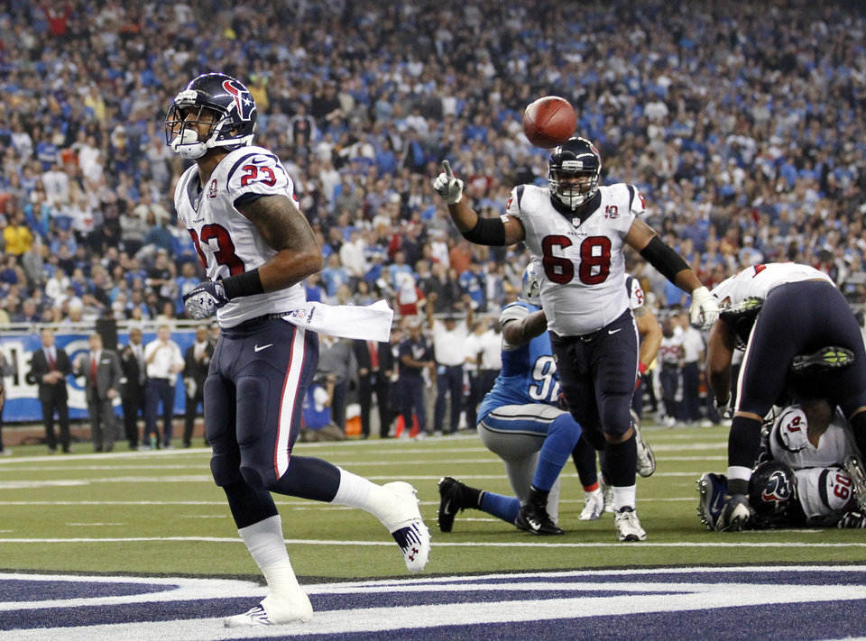 Photo -   Houston Texans running back Arian Foster, left, and teammate tackle Ryan Harris (68) celebrate after Foster's touchdown during the fourth quarter of an NFL football game against the Detroit Lions at Ford Field in Detroit, Thursday, Nov. 22, 2012. (AP Photo/Rick Osentoski)
