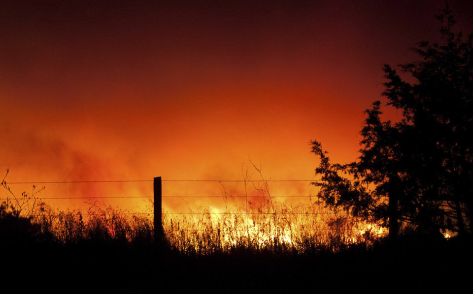 Photo - An orange glow could be seen for miles from the wildfire near Geary Okla.   Photo by Taylor Meriwether, for The Oklahoman.
