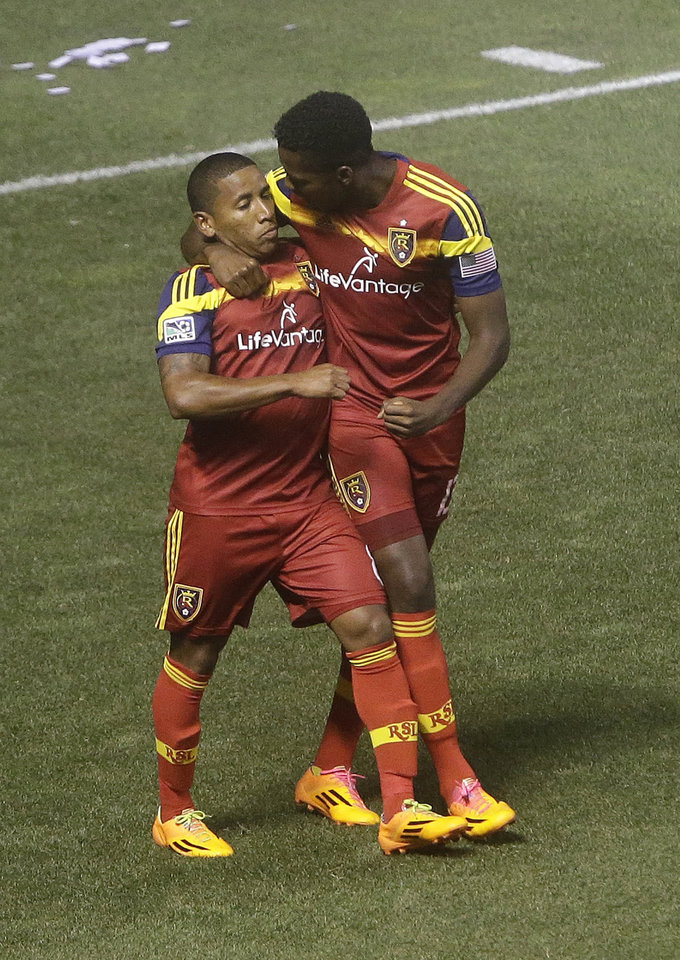 Photo - Real Salt Lake's Olmes Garcia, right, celebrates with Joao Plata (8) after scoring against the Montreal Impact during an MLS soccer game Thursday, July 24, 2014, in Sandy, Utah. (AP Photo/Rick Bowmer)