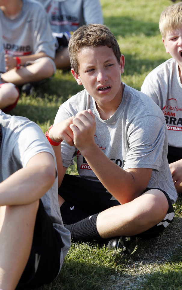 Photo - Camper Keaton Wingo, 14, (right) listens to announcements at Sam Bradford's Football Camp on the campus of the University of Oklahoma on Wednesday, July 11, 2012, in Norman, Okla.  Photo by Steve Sisney, The Oklahoman