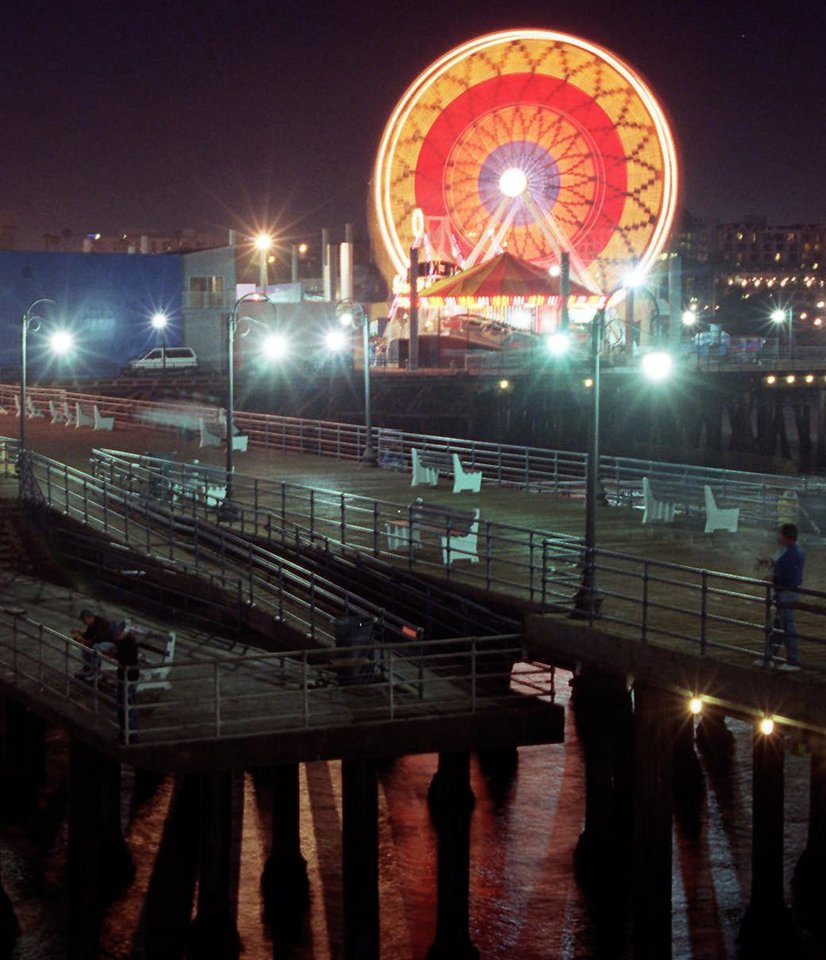 Photo - The Santa Monica Pier Ferris Wheel is shown in this May 1996 photo taken shortly before it was purchased on eBay to be included in development of the former Downtown Airpark along the Oklahoma River. The great wheel overlooking the ocean has provided some 3 million rides since it was installed at Pacific Park in 1996 and has been seen in hundreds of movies, TV shows, photographs and commercials.  AP File Photo  Rene Macura -  AP