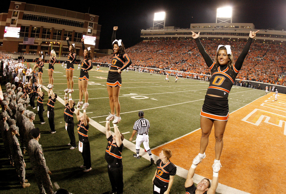 Photo - Cheerleaders during the college football game between the Oklahoma State University Cowboys (OSU) and the University of Texas Longhorns (UT) at Boone Pickens Stadium in Stillwater, Okla., Saturday, Oct. 31, 2009. Photo by Doug Hoke, The Oklahoman