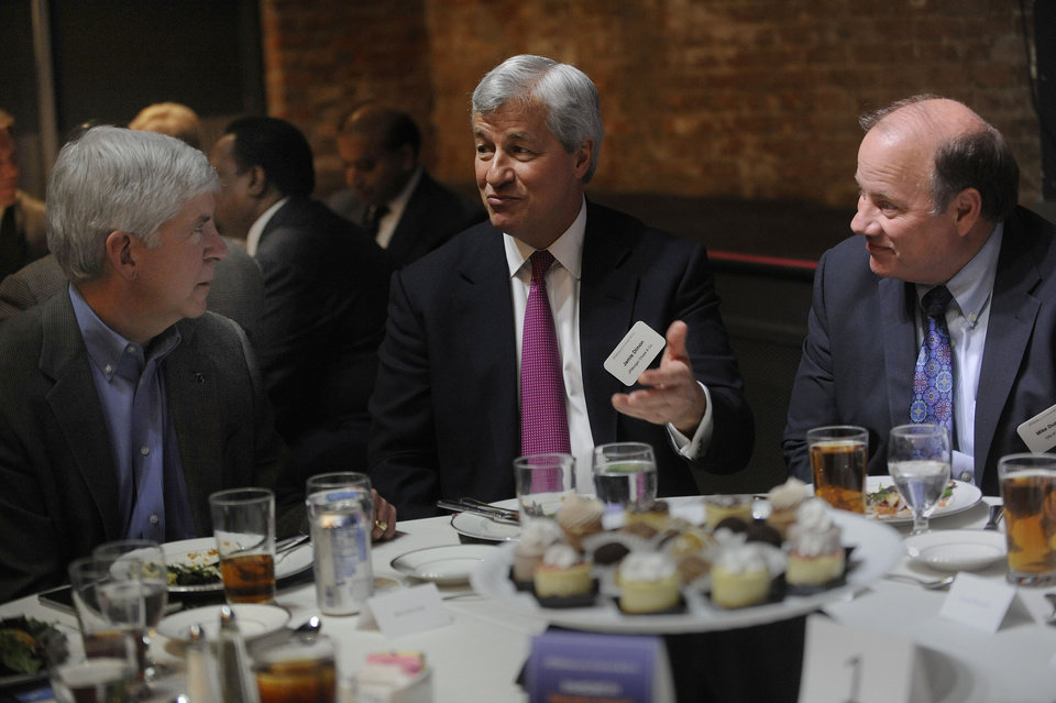 Photo - From left, Michigan Gov Rick Snyder, speaks with JP Morgan Chase  Chairman and CEO  Jamie Dimon and Detroit  Mayor Mike Duggan at the announcement, Wednesday, May 21. 2014, of the bank's plans to invest $100 million in the city over five years. (AP Photo/Detroit News, Chrles V. Tines)