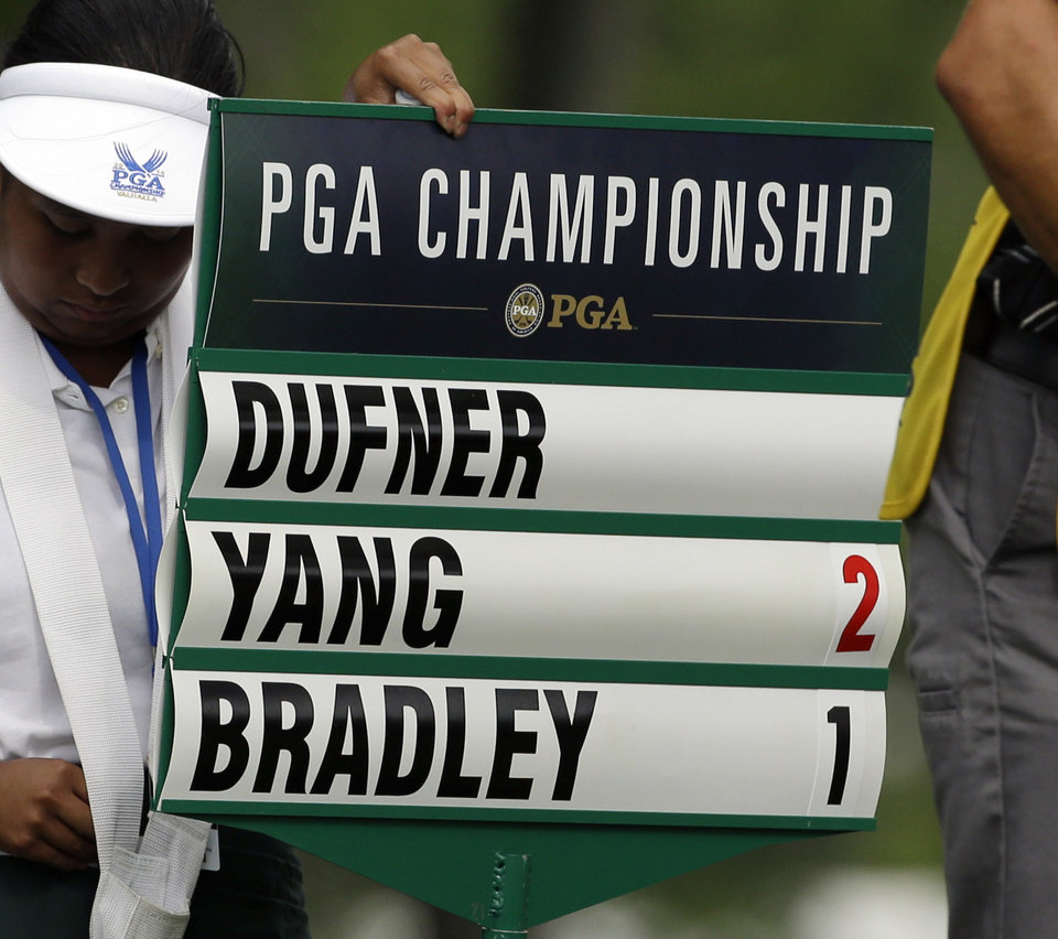 Photo - Jason Dufner's scorch is taken off the scoreboard after he withdraw after playing 10 holes during the first round of the PGA Championship golf tournament at Valhalla Golf Club on Thursday, Aug. 7, 2014, in Louisville, Ky. (AP Photo/John Locher)