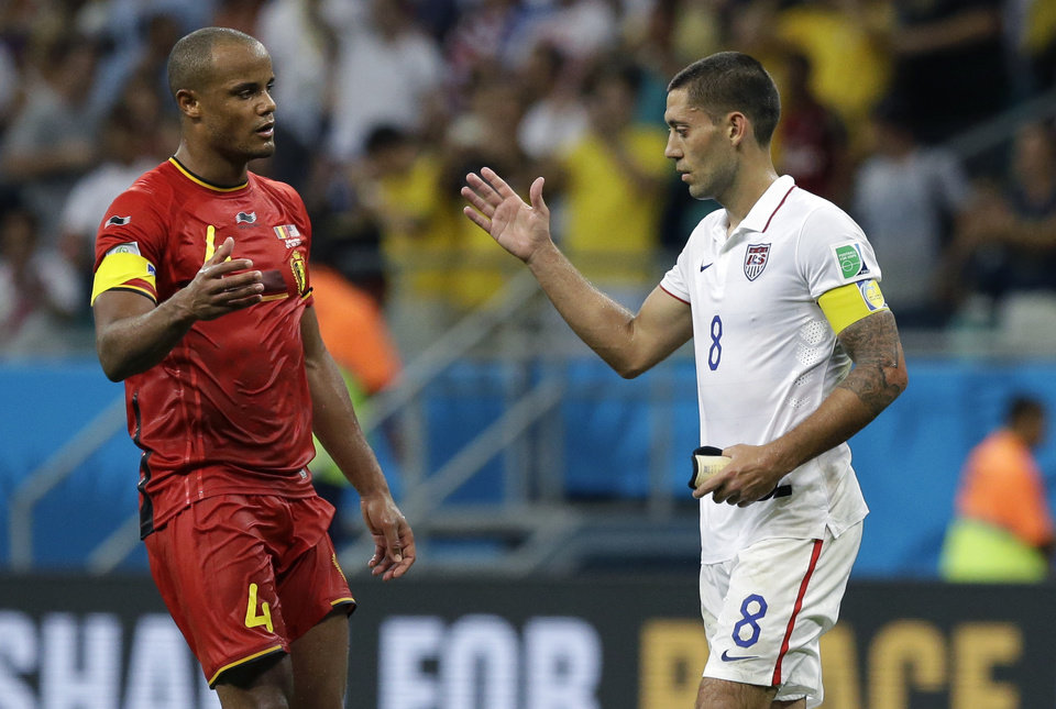 Photo - Belgium's Vincent Kompany, left, greets United States' Clint Dempsey after the World Cup round of 16 soccer match between Belgium and the USA at the Arena Fonte Nova in Salvador, Brazil, Tuesday, July 1, 2014. Belgium won the match 2-1 after extra-time. (AP Photo/Matt Dunham)