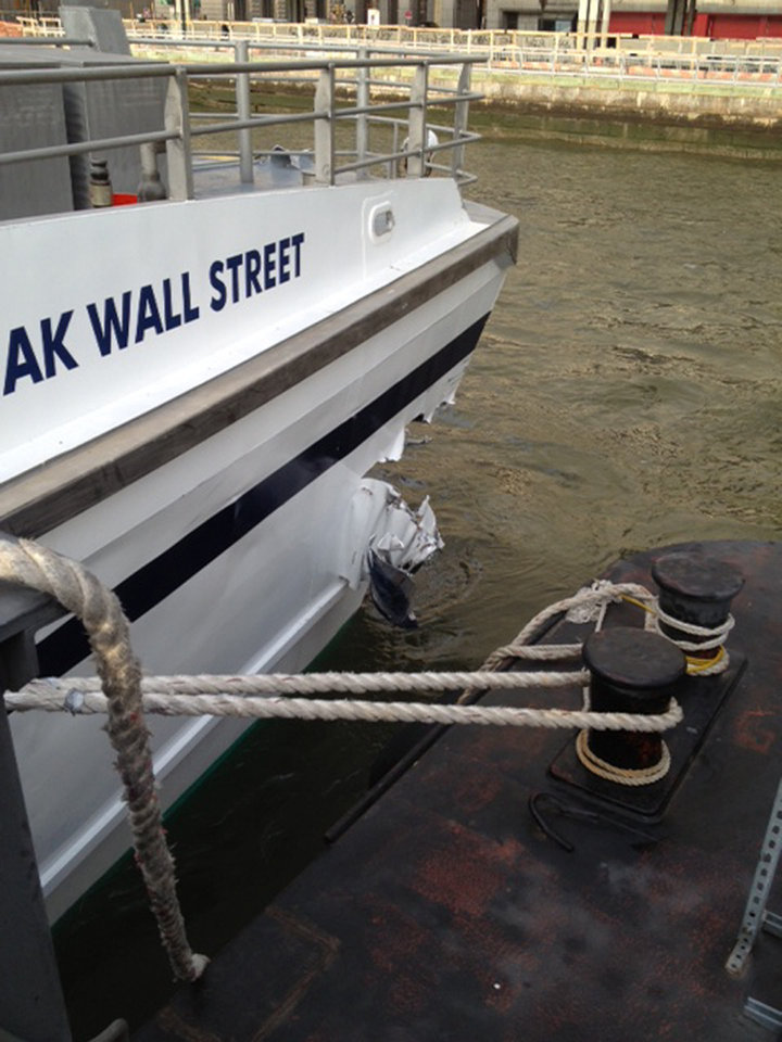 Photo - A hole is torn near the bow of the Seastreak Wall Street ferry after it banged into the mooring as it arrived at a pier in New York's financial district Wednesday, Jan. 9, 2013. Police and fire officials say 30 to 50 people were injured when the ferry struck a dock during the morning rush hour. (AP Photo/Larry Neumeister)
