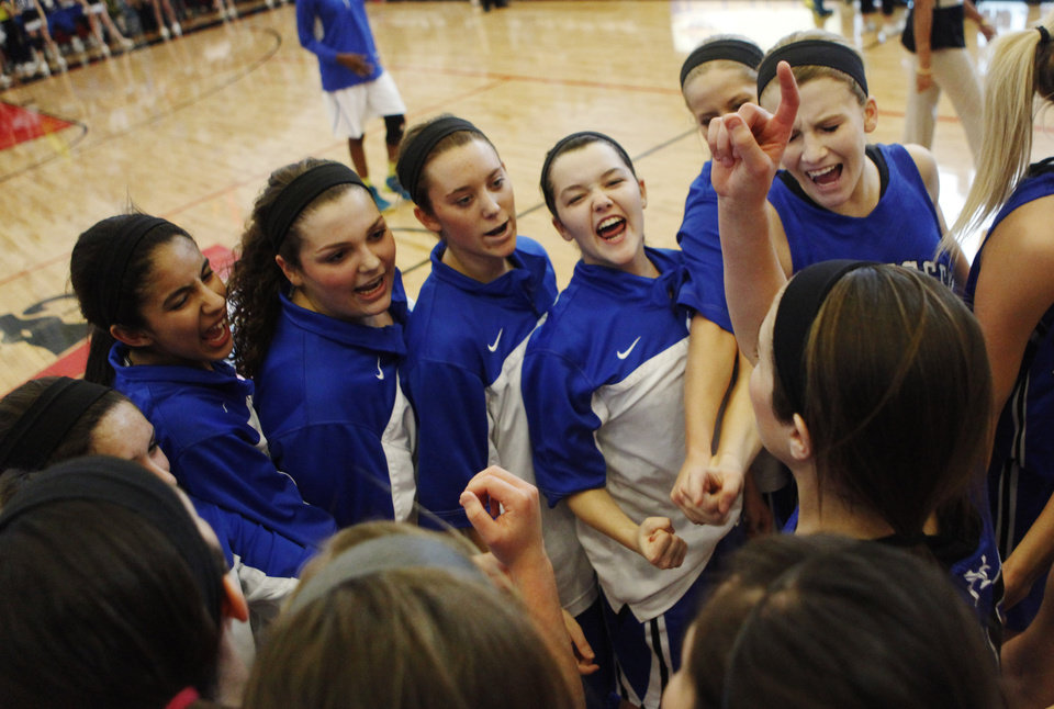 Photo - Hennessey girls huddle before the start of 2A Girls quarterfinals game between Hennessey and Millwood at Westmoore High School on Thursday, March 13, 2014. Millwood defeated Hennessey 34-27. Photo by KT King, The Oklahoman