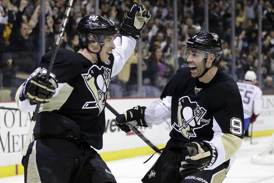 Pittsburgh Penguins center Sidney Crosby, left, celebrates his goal with right wing Pascal Dupuis (9) in the second period of an NHL hockey game against the Montreal Canadiens in Pittsburgh Tuesday, March 26, 2013.(AP Photo/Gene J. Puskar)