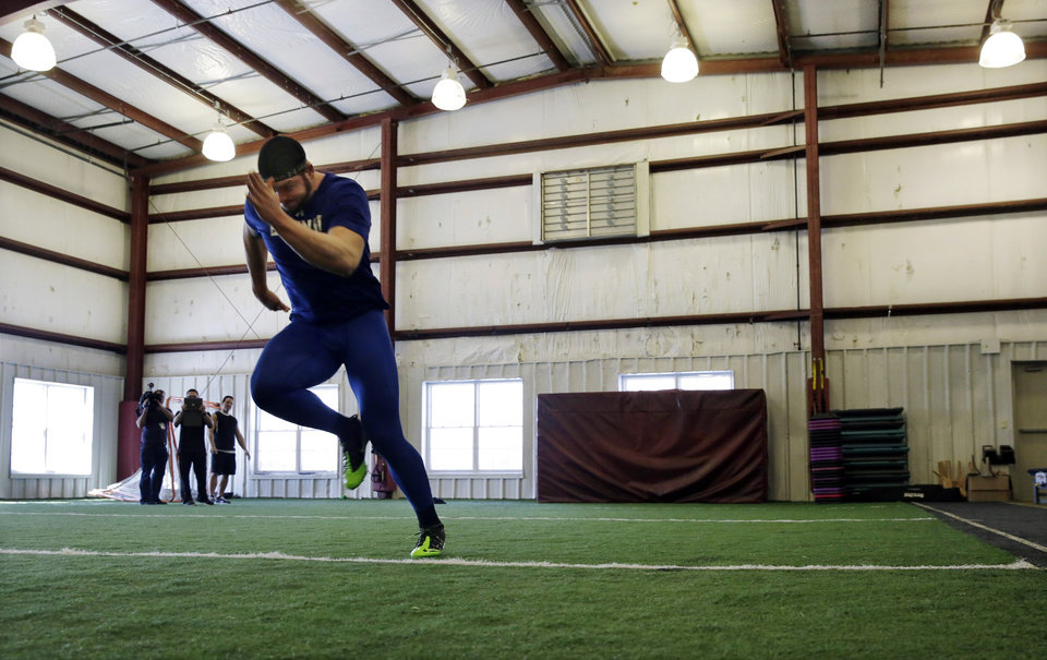 Photo - FILE - In this Friday, Feb. 14, 2014, file photo, Gallaudet defensive lineman Adham Talaat runs the 40-yard-dash at TEST Sports Clubs in Martinsville, N.J. Talaat has overcome being deaf to reach the doorstep of the NFL. After starring at Gallaudet University, working out at Test Parisi Football Academy and posted impressive numbers at his Pro Day, the talented defensive end is hopeful he'll get a call when the NFL draft kicks off next week. (AP Photo/Mel Evans,file)