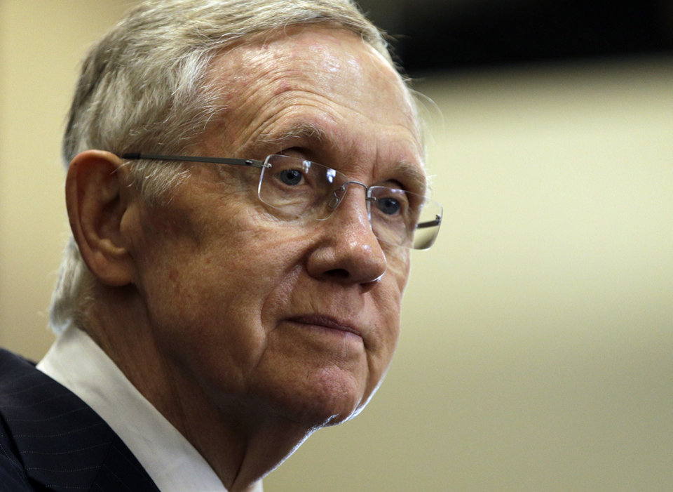 Photo - Senate Majority Leader Harry Reid, D-Nev., speaks at The Business of Water conference Friday, Aug. 29, 2014, in Las Vegas. The two-day conference drew more than 100 corporations, Main Street businesses, municipal water agencies and business associations, organizers said. (AP Photo/John Locher)
