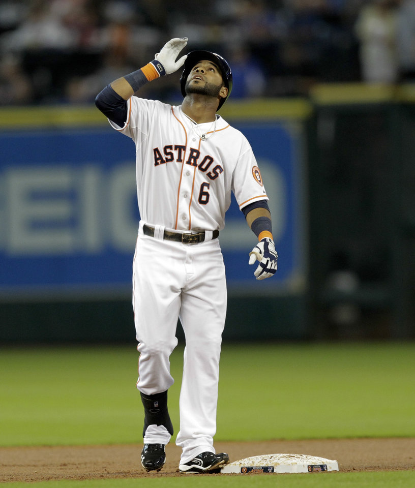 Photo - Houston Astros' Jonathan Villar reacts after hitting a double in the first inning against the Oakland Athletics during a baseball game on Tuesday, July 23, 2013, in Houston. (AP Photo/Bob Levey)
