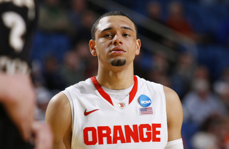 <strong>Tyler Ennis, Syracuse point guard</strong> He'd have to stumble a bit from his current projections, which place him somewhere in the mid- to late teens. But because of the top-to-bottom talent, that's going to happen to somebody in this draft. And if it's Ennis, that would seem to be a great fit for the Thunder, who now find themselves in the market for another point guard. At only 19, he showed a great feel for the game during his lone year at Syracuse, compiling a 3.2 assist-to-turnover ratio. If he falls, OKC would be lucky to snag him. (AP Photo/Bill Wippert)