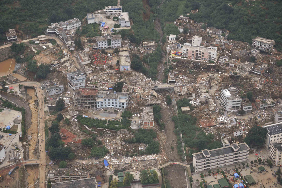 Photo - This aerial photo shows buildings toppled down by a 6.5-magnitude earthquake at the quake's epicenter in the town of Longtoushan in Ludian County of Zhaotong, southwest China's Yunnan Province, Monday, Aug. 4, 2014. Rescuers dug through shattered homes Monday looking for survivors of the strong earthquake in southern China as the death toll rose to hundreds of people, with more than 1,800 injured. (AP Photo/Xinhua, Xue Yubin) NO SALES