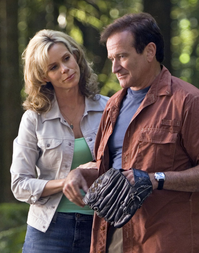Photo - This undated photo released by Columbia Pictures shows actress Cheryl Hines, left, and Robin Williams in a scene from the family-adventure comedy